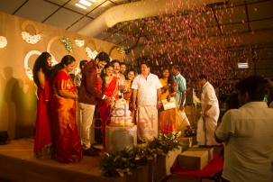 cake-cutting-with-flower-shower-ben-lalu-alex-betrothal-knanaya-wedding-planner-kochi
